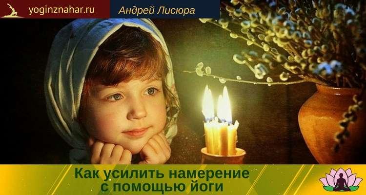 Девушка смотрит на свечу